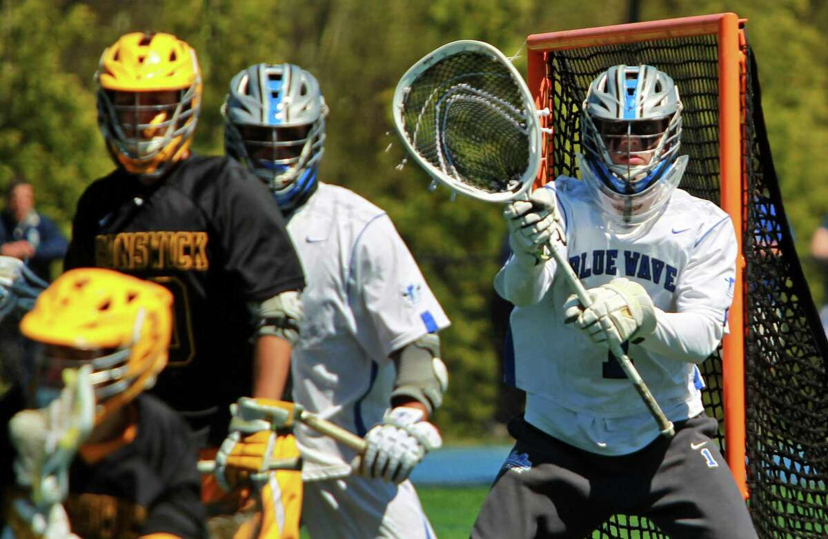 Darien goalie Andy Demopoulos stands ready as Brunswick looks to score during boys lacrosse action in Darien, Conn., on Saturday May 1, 2021.