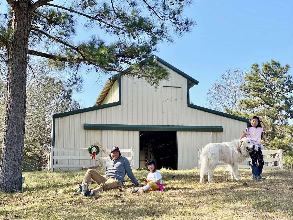 Fashion designer Theresa Pham and husband Shaw Nguyen and their daughter Loghan, 7, and Ava, 4, sold their home in Houston and bought a farm in August 2020 in Magnolia where she is growing a cut garden.