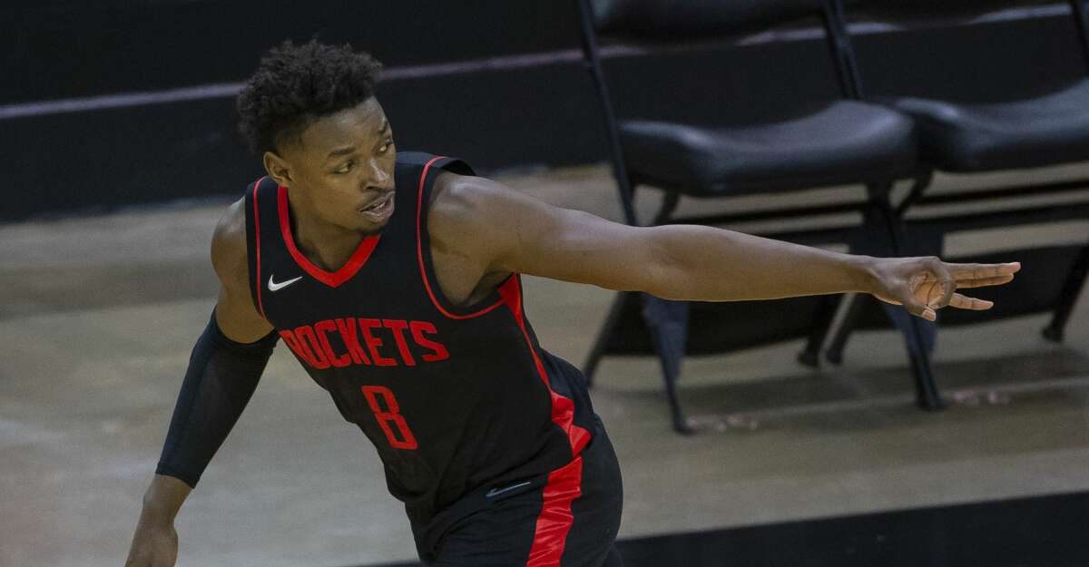 Houston Rockets forward Jae'Sean Tate (8) celebrates after hitting a 3-point shot during the fourth quarter of an NBA game between the Houston Rockets and Milwaukee Bucks on Thursday, April 29, 2021, at Toyota Center in Houston.