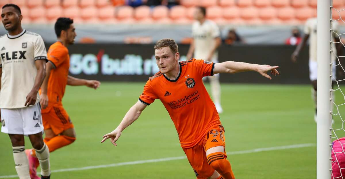 Houston Dynamo FC forward Tyler Pasher (19) celebrates after scoring the tying goal against the Los Angeles FC during the second half of an MLS match at BBVA Stadium on Saturday, May 1, 2021, in Houston. The game ended 1-1.