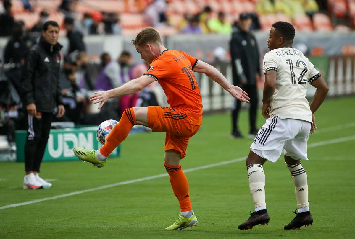 Houston Dynamo FC forward Tyler Pasher (19) brings down a high pass near the sideline during the second half of an MLS match against the Los Angeles FC at BBVA Stadium on Saturday, May 1, 2021, in Houston. The game ended 1-1.