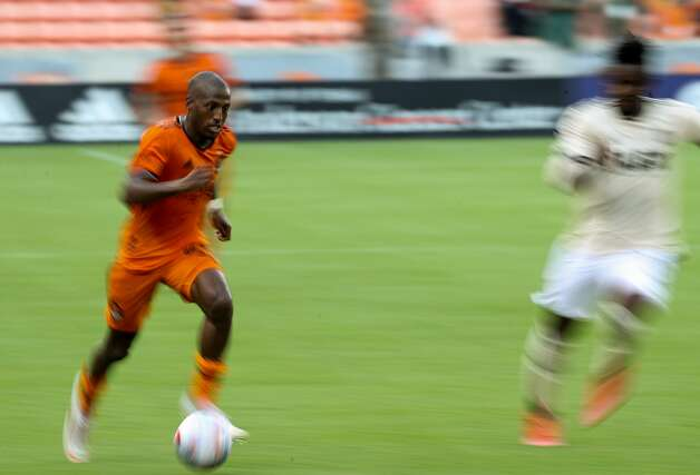 Houston Dynamo FC forward Fafa Picault (10) dribbles the ball upfield against the Los Angeles FC during the second half of an MLS match at BBVA Stadium on Saturday, May 1, 2021, in Houston. The game ended 1-1. Photo: Godofredo A Vásquez/Staff Photographer / © 2021 Houston Chronicle