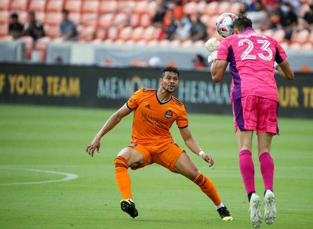 Los Angeles FC goalkeeper Pablo Sisniega (23) headers the ball before Houston Dynamo FC forward Ariel Lassiter (11) could get to it during the second half of an MLS match at BBVA Stadium on Saturday, May 1, 2021, in Houston. The game ended 1-1. Photo: Godofredo A Vásquez/Staff Photographer / © 2021 Houston Chronicle