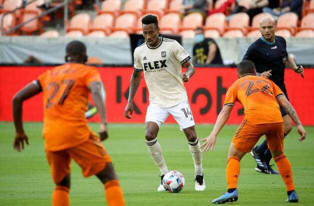 Los Angeles FC midfielder Mark-Anthony Kaye (14) dribbles the ball against Houston Dynamo FC during the first half of an MLS match at BBVA Stadium on Saturday, May 1, 2021, in Houston. Photo: Godofredo A Vásquez/Staff Photographer / © 2021 Houston Chronicle