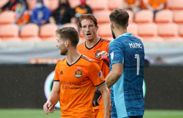 Houston Dynamo FC goalkeeper Marko Maric (1) fist bumps defender Tim Parker (5) after a defensive stop against the Los Angeles FC during the first half of an MLS match at BBVA Stadium on Saturday, May 1, 2021, in Houston. Photo: Godofredo A Vásquez/Staff Photographer / © 2021 Houston Chronicle