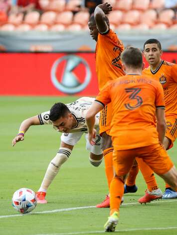 Los Angeles FC midfielder Eduard Atuesta (20) tries to maintain his balance as Houston Dynamo FC players surround him during the first half of an MLS match at BBVA Stadium on Saturday, May 1, 2021, in Houston. Photo: Godofredo A Vásquez/Staff Photographer / © 2021 Houston Chronicle