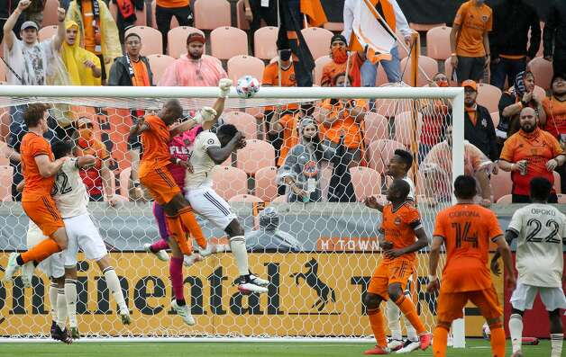 Los Angeles FC goalkeeper Pablo Sisniega (23) clears the ball away from goal on a corner kick during the first half of an MLS match against Houston Dynamo FC at BBVA Stadium on Saturday, May 1, 2021, in Houston. Photo: Godofredo A Vásquez/Staff Photographer / © 2021 Houston Chronicle