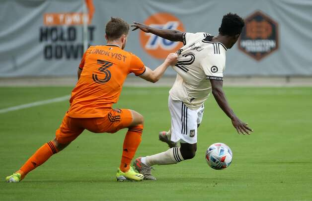 Houston Dynamo FC defender Adam Lundqvist (3) defends against Los Angeles FC forward Kwadwo Opoku (22) during the first half of an MLS match at BBVA Stadium on Saturday, May 1, 2021, in Houston. Photo: Godofredo A Vásquez/Staff Photographer / © 2021 Houston Chronicle