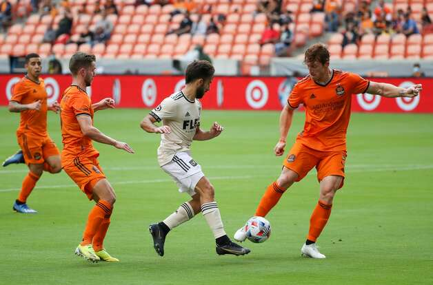 Houston Dynamo FC defender Tim Parker (5) clears the ball out fo bounds against the Los Angeles FC during the first half of an MLS match at BBVA Stadium on Saturday, May 1, 2021, in Houston. Photo: Godofredo A Vásquez/Staff Photographer / © 2021 Houston Chronicle