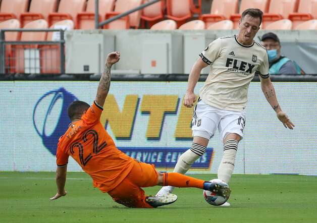 Houston Dynamo FC midfielder Matias Vera (22) slides to take the ball away from Los Angeles FC forward Corey Baird (13) during the first half of an MLS match at BBVA Stadium on Saturday, May 1, 2021, in Houston. Photo: Godofredo A Vásquez/Staff Photographer / © 2021 Houston Chronicle