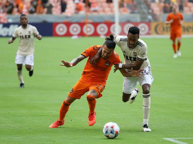 Los Angeles FC midfielder Mark-Anthony Kaye (14) commits a foul against Houston Dynamo FC forward Maximiliano Urruti (37) during the second half of an MLS match at BBVA Stadium on Saturday, May 1, 2021, in Houston. The game ended 1-1. Photo: Godofredo A Vásquez/Staff Photographer / © 2021 Houston Chronicle