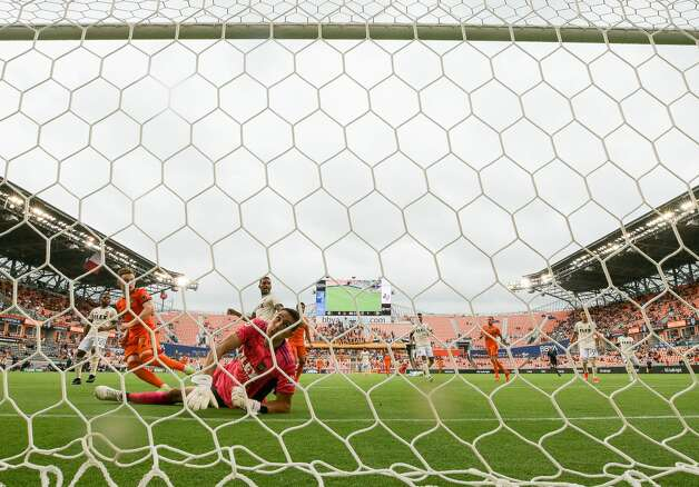 Houston Dynamo FC forward Tyler Pasher (19) scores the tying goal against Los Angeles FC goalkeeper Pablo Sisniega (23) during the second half of an MLS match at BBVA Stadium on Saturday, May 1, 2021, in Houston. The game ended 1-1. Photo: Godofredo A Vásquez/Staff Photographer / © 2021 Houston Chronicle