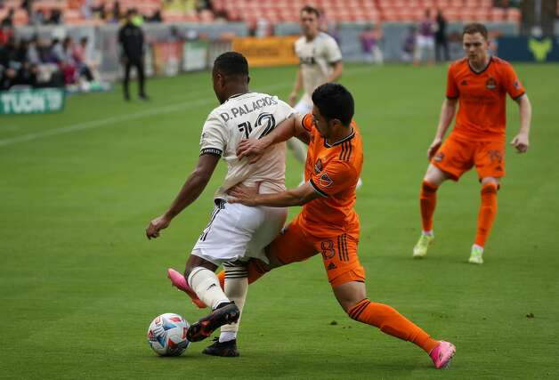 Los Angeles FC defender Diego Palacios (12) takes the ball away from Houston Dynamo FC midfielder Memo Rodriguez (8) during the second half of an MLS match at BBVA Stadium on Saturday, May 1, 2021, in Houston. The game ended 1-1. Photo: Godofredo A Vásquez/Staff Photographer / © 2021 Houston Chronicle