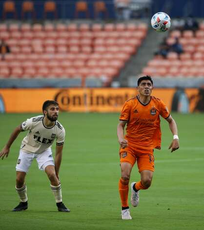 Houston Dynamo FC midfielder Joe Corona (14) tracks the ball to regain possession against the Los Angeles FC during the second half of an MLS match at BBVA Stadium on Saturday, May 1, 2021, in Houston. The game ended 1-1. Photo: Godofredo A Vásquez/Staff Photographer / © 2021 Houston Chronicle