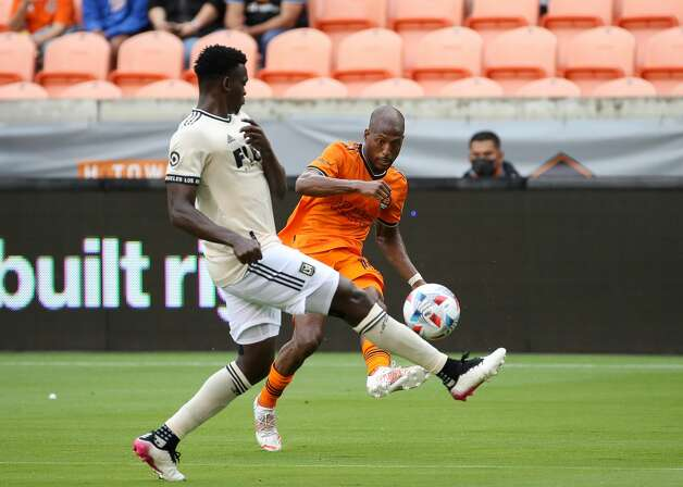 Houston Dynamo FC forward Fafa Picault (10) crosses the ball to forward Tyler Pasher (19) who scored the tying goal against the Los Angeles FC during the second half of an MLS match at BBVA Stadium on Saturday, May 1, 2021, in Houston. The game ended 1-1. Photo: Godofredo A Vásquez/Staff Photographer / © 2021 Houston Chronicle