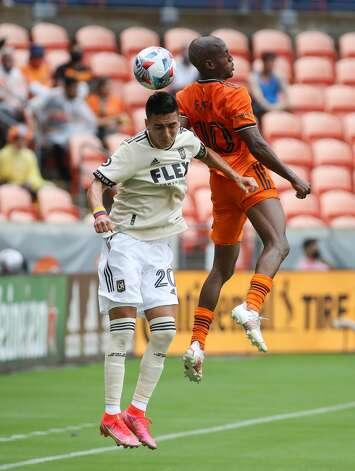 Los Angeles FC midfielder Eduard Atuesta (20) and Houston Dynamo FC forward Fafa Picault (10) jump to header the ball during the second half of an MLS match at BBVA Stadium on Saturday, May 1, 2021, in Houston. The game ended 1-1. Photo: Godofredo A Vásquez/Staff Photographer / © 2021 Houston Chronicle