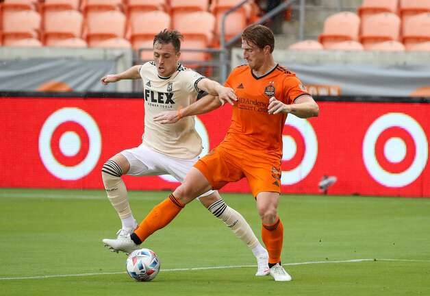 Houston Dynamo FC defender Tim Parker (5) shields the ball away from Los Angeles FC forward Corey Baird (13) inside the 18-yard-box during the first half of an MLS match at BBVA Stadium on Saturday, May 1, 2021, in Houston. Photo: Godofredo A Vásquez/Staff Photographer / © 2021 Houston Chronicle