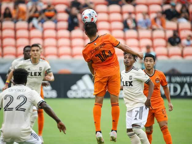 Houston Dynamo FC midfielder Joe Corona (14) headers the ball during the first half of an MLS match against the Los Angeles FC at BBVA Stadium on Saturday, May 1, 2021, in Houston. Photo: Godofredo A Vásquez/Staff Photographer / © 2021 Houston Chronicle