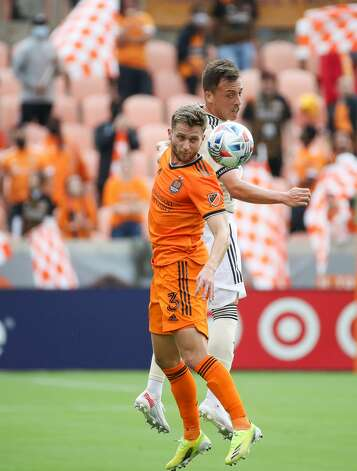 Houston Dynamo FC defender Adam Lundqvist (3) headers the ball against the Los Angeles FC during the first half of an MLS match at BBVA Stadium on Saturday, May 1, 2021, in Houston. Photo: Godofredo A Vásquez/Staff Photographer / © 2021 Houston Chronicle
