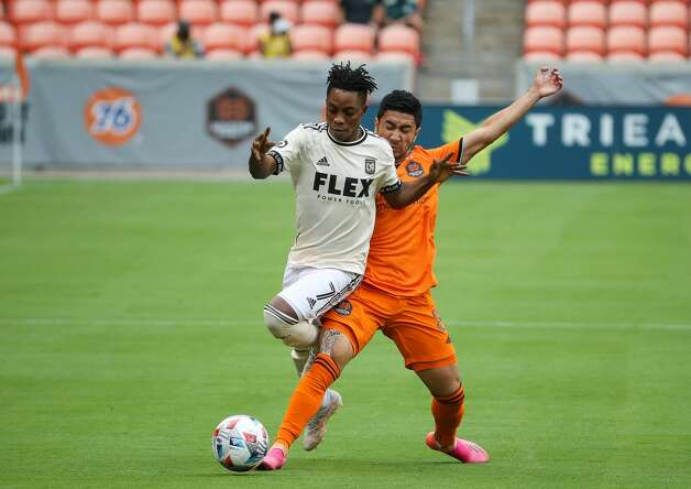 Houston Dynamo FC midfielder Memo Rodriguez (8) pokes the ball away from Los Angeles FC midfielder Latif Blessing (7) during the first half of an MLS match at BBVA Stadium on Saturday, May 1, 2021, in Houston. Photo: Godofredo A Vásquez/Staff Photographer / © 2021 Houston Chronicle