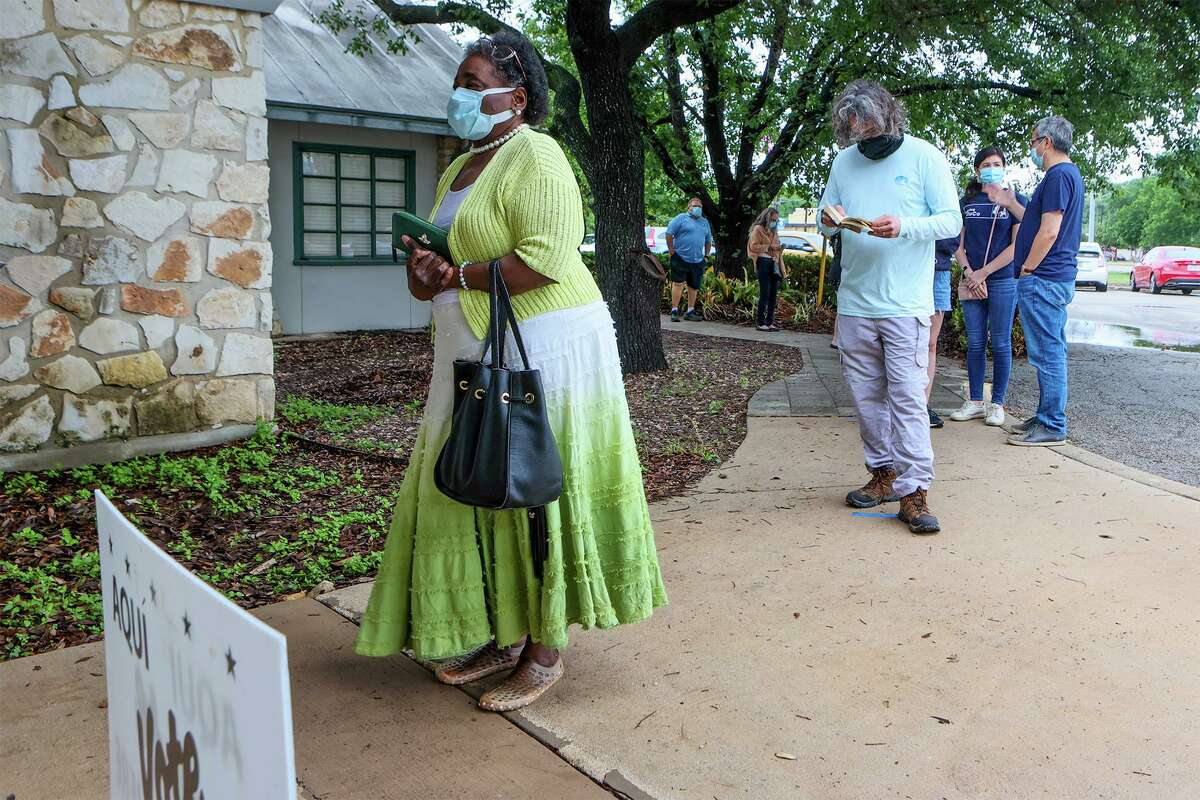Cynthia White, left, waits in line to vote in the May 2021 election at the Lions Field Adult and Senior Center, 2809 Broadway St., on Saturday, May 1, 2021.