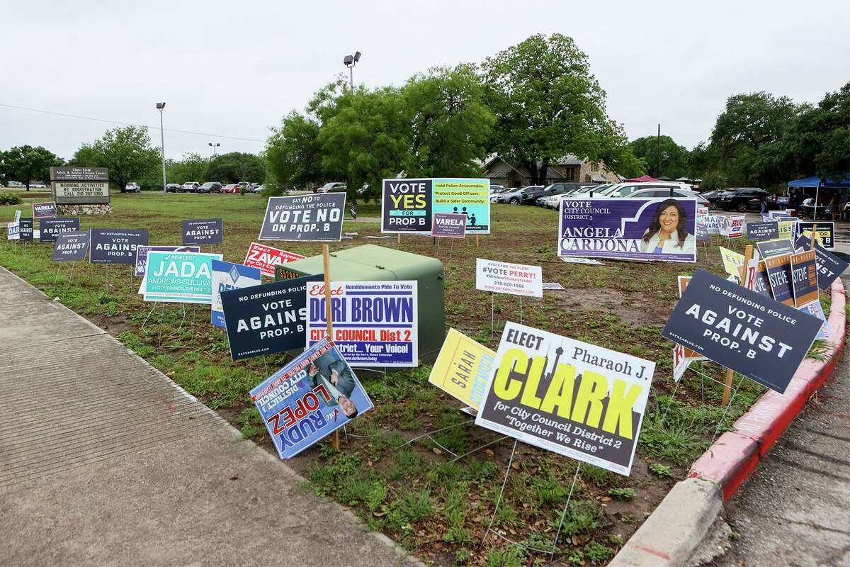 Election signs for the May 2021 election line the street outside the Lions Field Adult and Senior Center, 2809 Broadway St, on Saturday, May 1, 2021.
