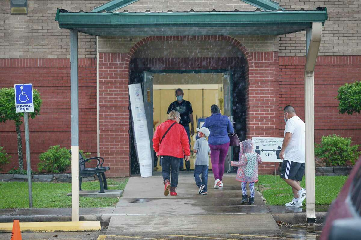 Voters had to deal with pouring rain during Saturday's elections at the East Harris County Activity Center and at other polling spots throughout the region.