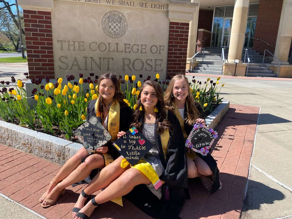 College of Saint Rose graduates have been taking photos on campus in their caps and gowns with the nice weather Saturday. The college plans three commencement ceremonies at the Times Union Center May 7 and 8.Here, three students take photos by the college's sign on Madison Avenue - a popular backdrop. In the photo are, from left, Jessica Sokol of Waterford, Hannah Magliocca of Amsterdam, and Casey Baumeister of Herkimer.