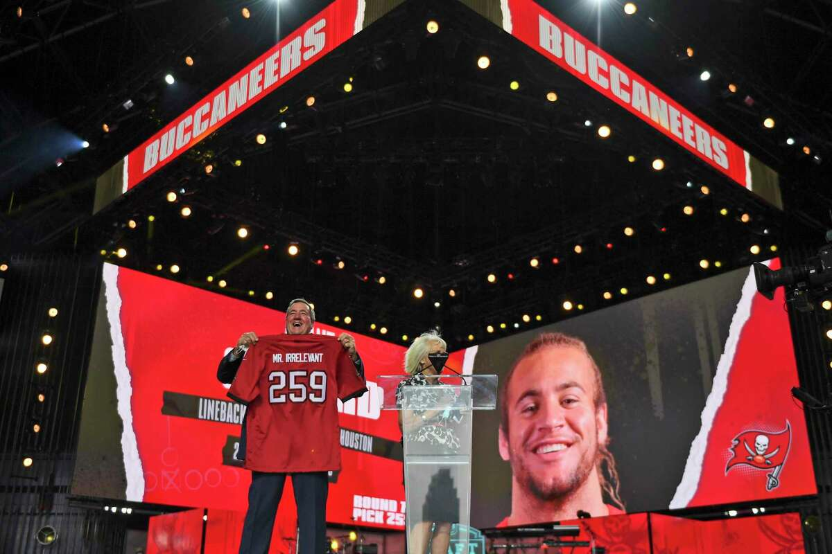 A Mr. Irrelevant jersey is held up for the Tampa Bay Buccaneers' pick during the seventh round of the NFL football draft, Saturday, May 1, 2021, in Cleveland. The final pick of the draft was Grant Stuard, a linebacker from Houston.