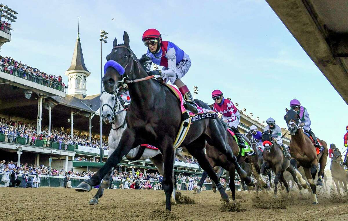 Medina Spirit with jockey John Velazquez aboard passes the finish line for the first time on the way to the win in the 147th running of The Kentucky Derby at Churchill Downs Race Track Saturday May 1, 2021 in Louisville, Kentucky. Photo Special to the Times Union by Skip Dickstein