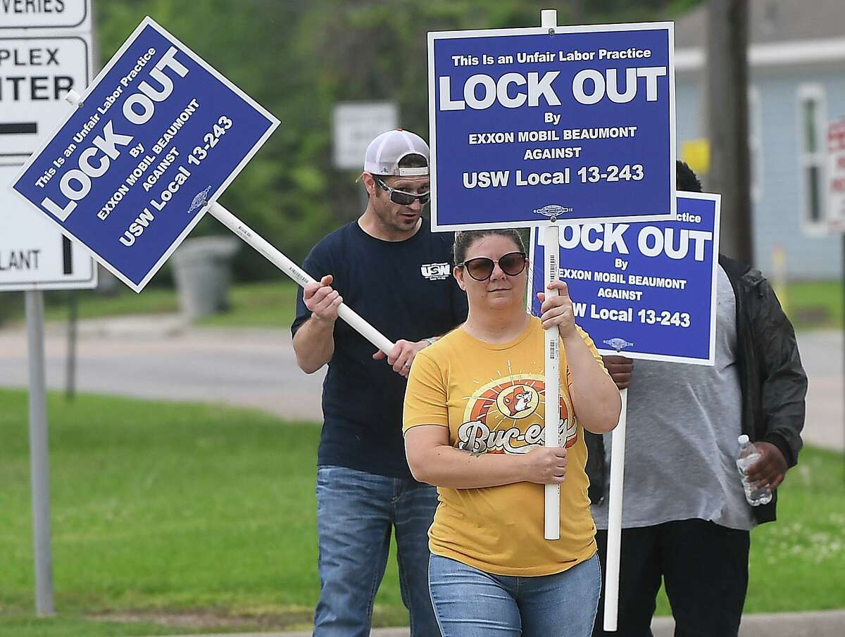 ExxonMobil and United Steel Workers Union members picket outside the plant Saturday afternoon after all the workers had been escorted out in a lockout. Photo made Saturday, May 1, 2021 Kim Brent/The Enterprise