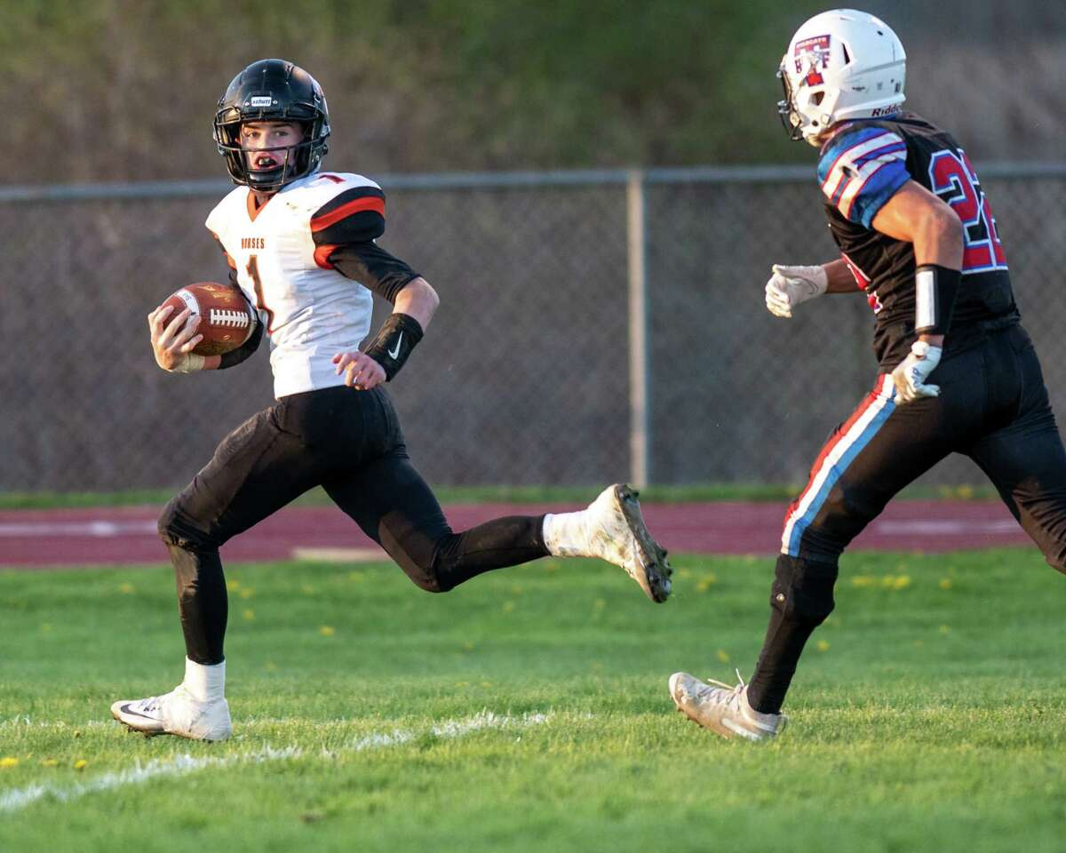 Schuylerville senior Jack Dwyer looks back at Tamarac/Hoosick Falls senior Peyton Nealon before scoring a touchdown during the Class C finals at Tamarac High School on Saturday, May 1, 2021. (Jim Franco/Special to the Times Union)