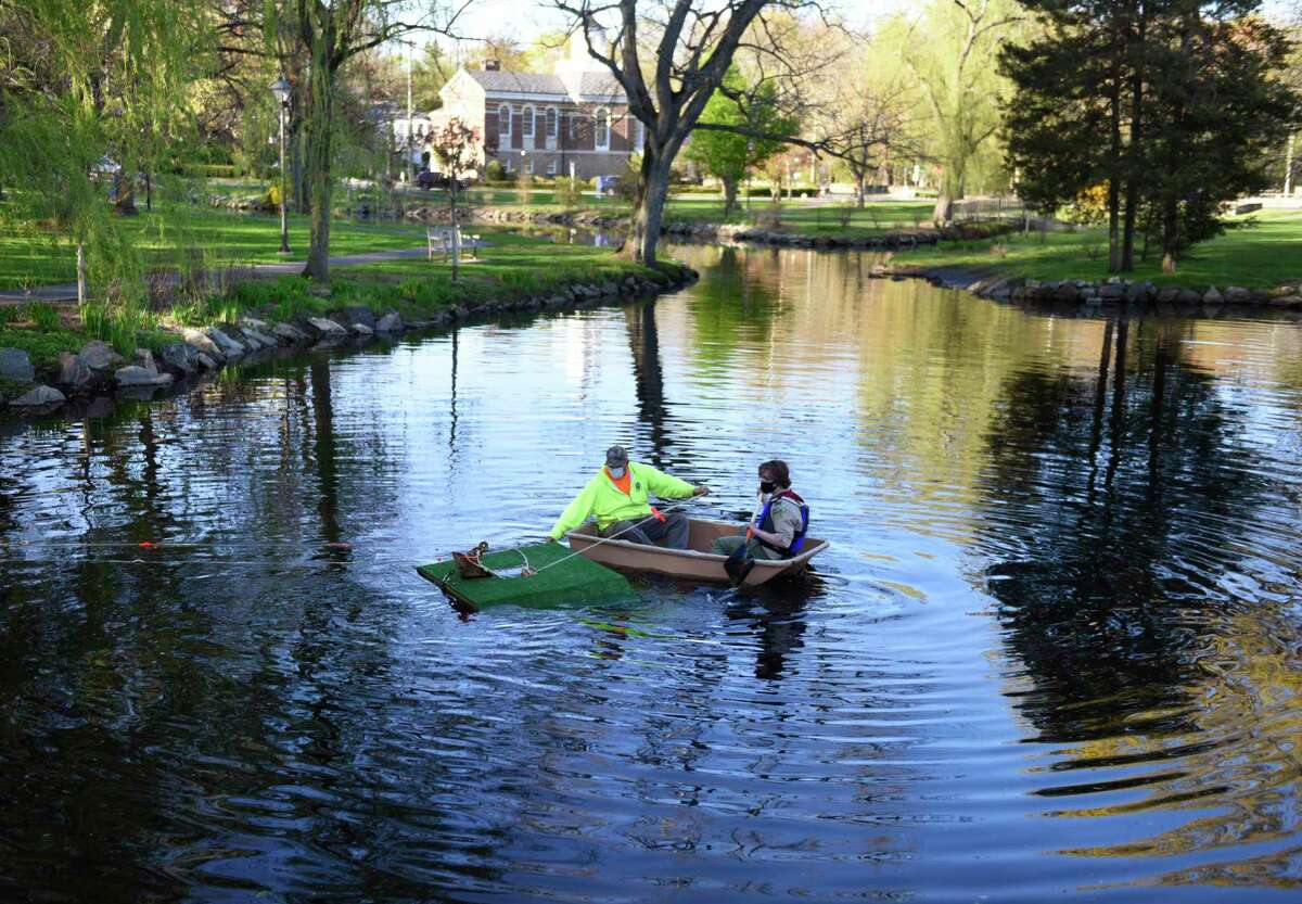 Greenwich sophomore William van Rhyn, right, and park foreman Jonathan Fasone set up a turtle sanctuary at Binney Park Pond in Old Greenwich, Conn. Monday, April 26, 2021. For his Eagle Scout service project, Van Rhyn constructed two floating boards lined with turf to provide a habitat for turtles in the pond at Binney Park in cooperation with the town.