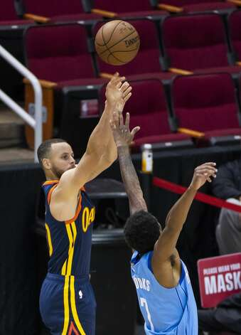 Golden State Warriors guard Stephen Curry (30) shoots a three point shot over Houston Rockets guard Armoni Brooks (7) during the third quarter of an NBA game between the Houston Rockets and Golden State Warriors on Saturday, May 1, 2021, at Toyota Center in Houston. Photo: Mark Mulligan/Staff Photographer / © 2021 Mark Mulligan / Houston Chronicle
