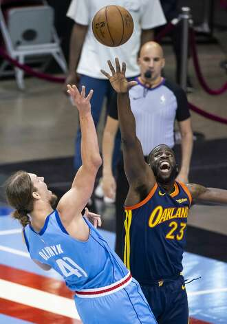 Houston Rockets forward Kelly Olynyk (41) shoots over Golden State Warriors forward Draymond Green (23) during the first quarter of an NBA game between the Houston Rockets and Golden State Warriors on Saturday, May 1, 2021, at Toyota Center in Houston. Photo: Mark Mulligan/Staff Photographer / © 2021 Mark Mulligan / Houston Chronicle
