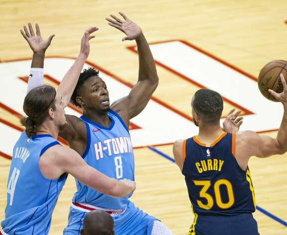 Houston Rockets forward Kelly Olynyk (41) and Houston Rockets forward Jae'Sean Tate (8) double-team Golden State Warriors guard Stephen Curry (30) during the first quarter of an NBA game between the Houston Rockets and Golden State Warriors on Saturday, May 1, 2021, at Toyota Center in Houston. Photo: Mark Mulligan/Staff Photographer / © 2021 Mark Mulligan / Houston Chronicle