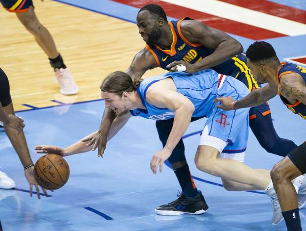 Houston Rockets forward Kelly Olynyk (41) is defended by Golden State Warriors forward Draymond Green (23) during the first quarter of an NBA game between the Houston Rockets and Golden State Warriors on Saturday, May 1, 2021, at Toyota Center in Houston. Photo: Mark Mulligan/Staff Photographer / © 2021 Mark Mulligan / Houston Chronicle