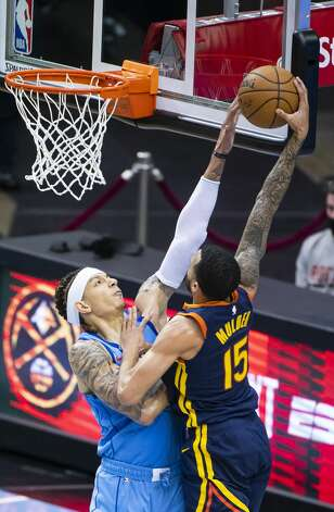 Houston Rockets forward D.J. Wilson (00) blocks a shot by Golden State Warriors guard Mychal Mulder (15) during the fourth quarter of an NBA game between the Houston Rockets and Golden State Warriors on Saturday, May 1, 2021, at Toyota Center in Houston. Photo: Mark Mulligan/Staff Photographer / © 2021 Mark Mulligan / Houston Chronicle