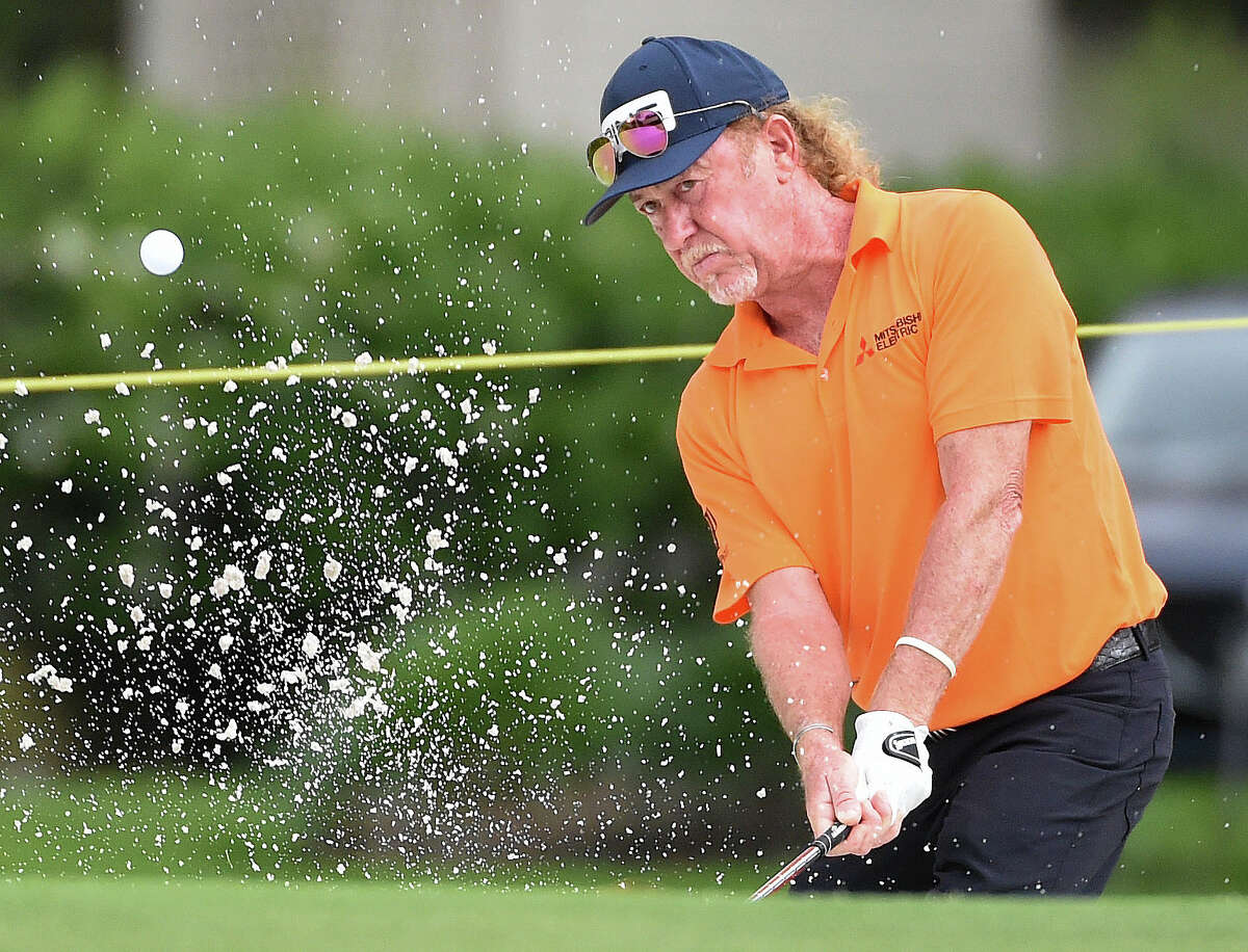 Miguel Angel Jimenez blasts out of a greenside bunker on the first hole during the first round of the Insperity Invitational golf tournament, Saturday, May 1, 2021, in The Woodlands, TX.