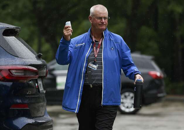 Champions Tour golfer Sandy Lyle gestures towards caddies while walking to the clubhouse during a weather delay before the first round of the Insperity Invitational golf tournament, Saturday, May 1, 2021, in The Woodlands, TX. Photo: Eric Christian Smith/Contributor
