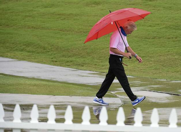 PGA Tour Champions physical therapist Paul Schueren walks near the 18th green during a weather delay before the first round of the Insperity Invitational golf tournament, Saturday, May 1, 2021, in The Woodlands, TX. Photo: Eric Christian Smith/Contributor