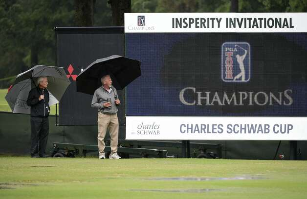Driving range workers Paul Vance, left, and Jeff Smith walk the driving range during a weather delay before the first round of the Insperity Invitational golf tournament, Saturday, May 1, 2021, in The Woodlands, TX. Photo: Eric Christian Smith/Contributor