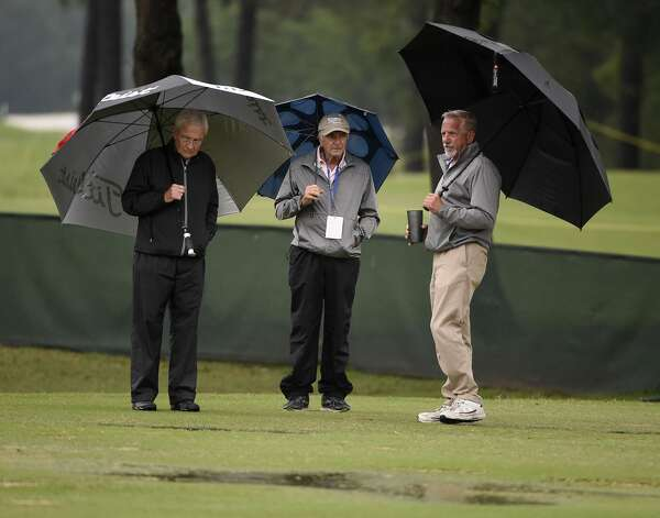 Driving range workers (left to right) Paul Vance, Michael Deo, and Jeff Smith inspect the driving range during a weather delay before the first round of the Insperity Invitational golf tournament, Saturday, May 1, 2021, in The Woodlands, TX. Photo: Eric Christian Smith/Contributor