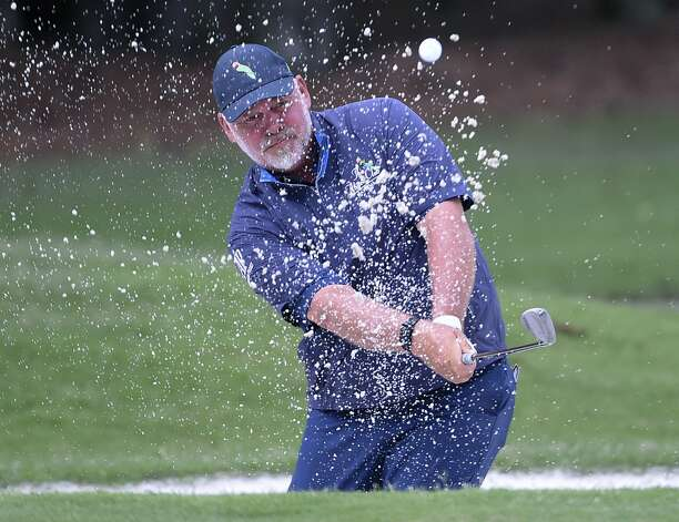 Darren Clarke blasts out of a greenside bunker on the first hole during the first round of the Insperity Invitational golf tournament, Saturday, May 1, 2021, in The Woodlands, TX. Photo: Eric Christian Smith/Contributor