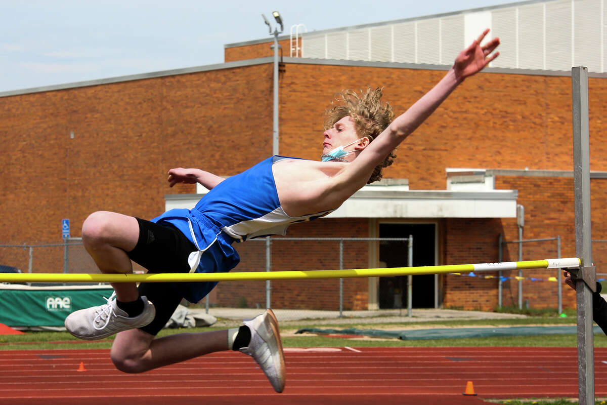 Midland's Brennan Archbold competes in the high jump event during the Graves/Swayze Relays Saturday, May 1, 2021 at H. H. Dow High School. (Doug Julian/for the Daily News)