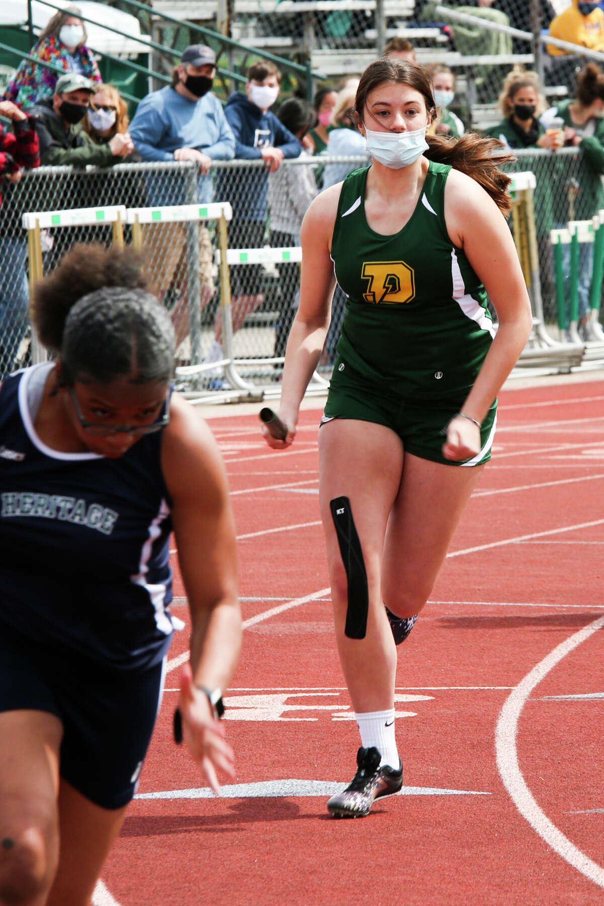 Dow's Emilee Bonter competes in a relay during the Graves/Swayze Relays Saturday, May 1, 2021 at H. H. Dow High School. (Doug Julian/for the Daily News)
