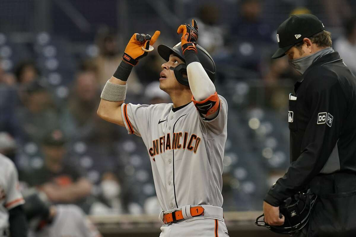 San Francisco Giants' Mauricio Dubon reacts after hitting a home run during the fifth inning of a baseball game against the San Diego Padres, Saturday, May 1, 2021, in San Diego. (AP Photo/Gregory Bull)