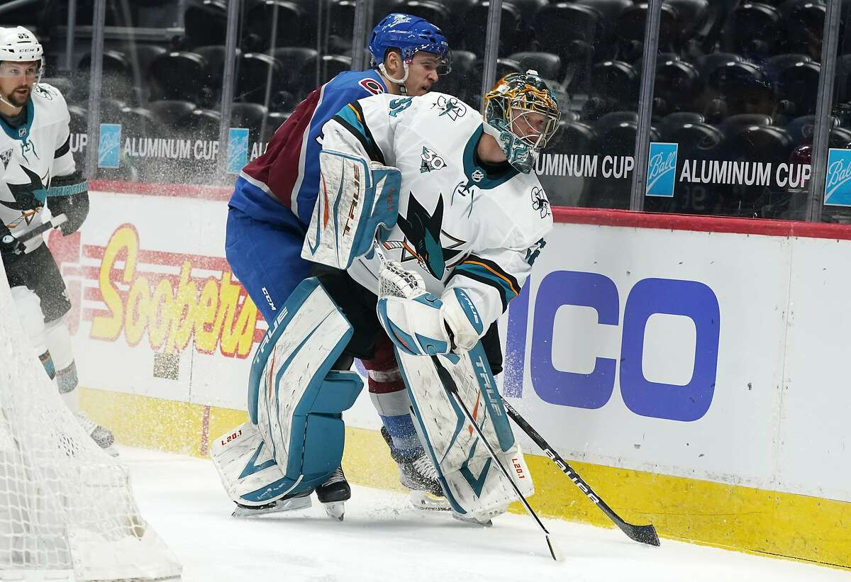 Sharks goaltender Josef Korenar, who made 40 saves, clears the puck as Avalanche right wing Mikko Rantanen trails the play in the second period.