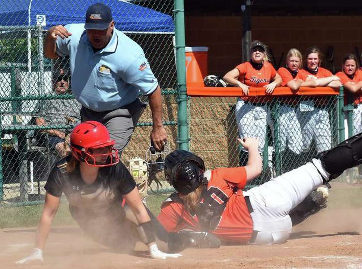 Edwardsville catcher Abbie Hall looks to the umpire for the call after tagging Calhoun's Charleigh Wilson in the third inning of Saturday's game inside the District 7 Sports Complex.