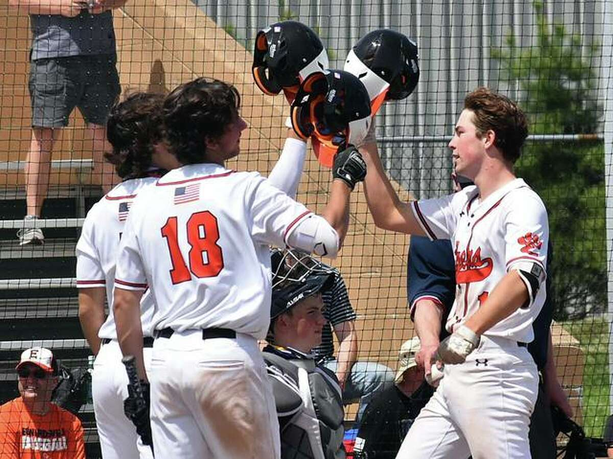 Edwardsville's Evan Funkhouser, right, is congratulated by teammates after hitting a two-run home run in the sixth inning.